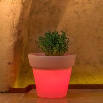 Vaso luminoso rotondo da giardino in resina bianca per esterno. Vasi luminosi circolari da interno illuminati di luce rossa, ideale per le piante del terrazzo.
