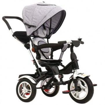 Triciclo grigio per bambino con cappottina e tre ruote gonfiabili. Tricicli passeggino a pedali per bambini
