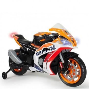 Moto elettrica per bambini Repsol con batteria 12 Volt, luci a led e musica. Motocicletta per bambino con ingresso Mp3 e ruote in gomma.